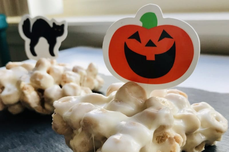 Halloween treats with pumpkin and cat decorations