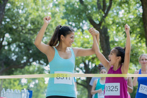 Mother and daughter at the finish line of a race