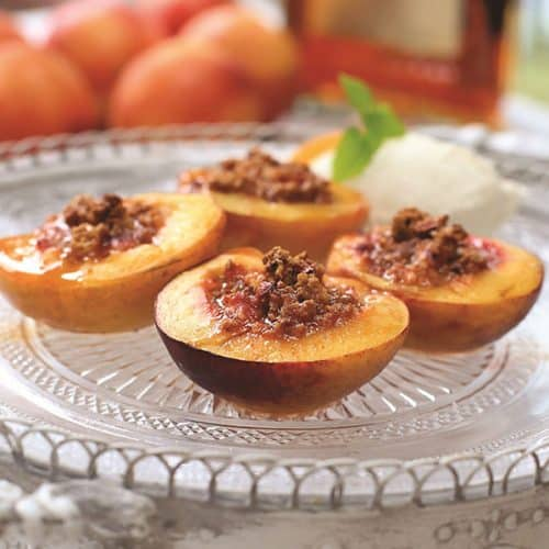 Baked peaches on plate