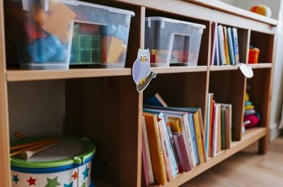 bookshelf with books and toys at daycare