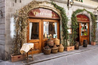 view of trattoria door with baskets piled beside it