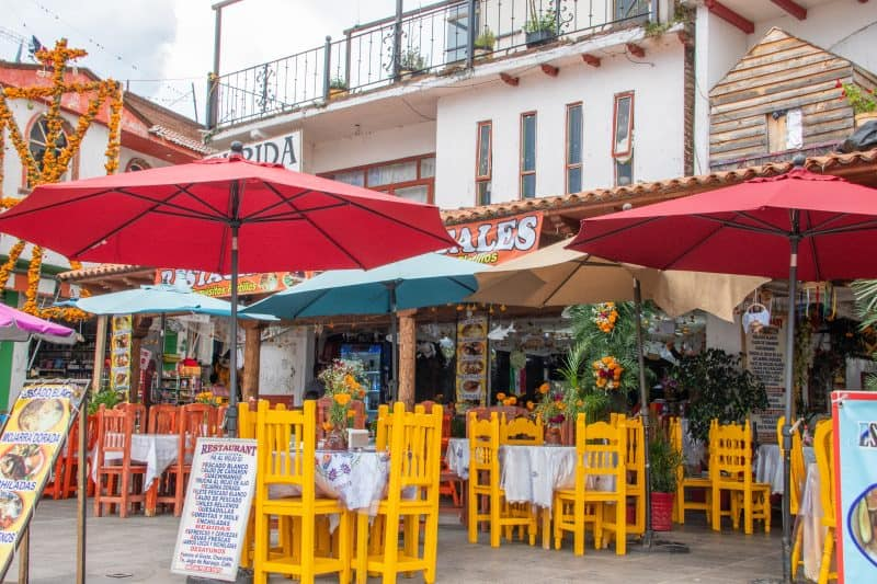 view of tables and umbrellas outside Mexican restaurant