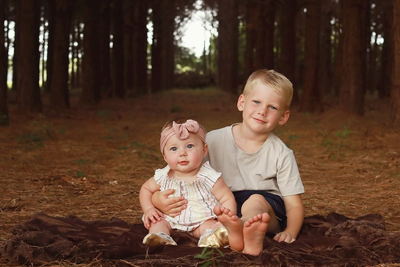 Aspen and Finn seated on the ground